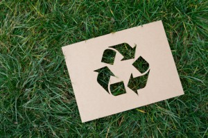 recycle sign on grass; tips for recycling content
